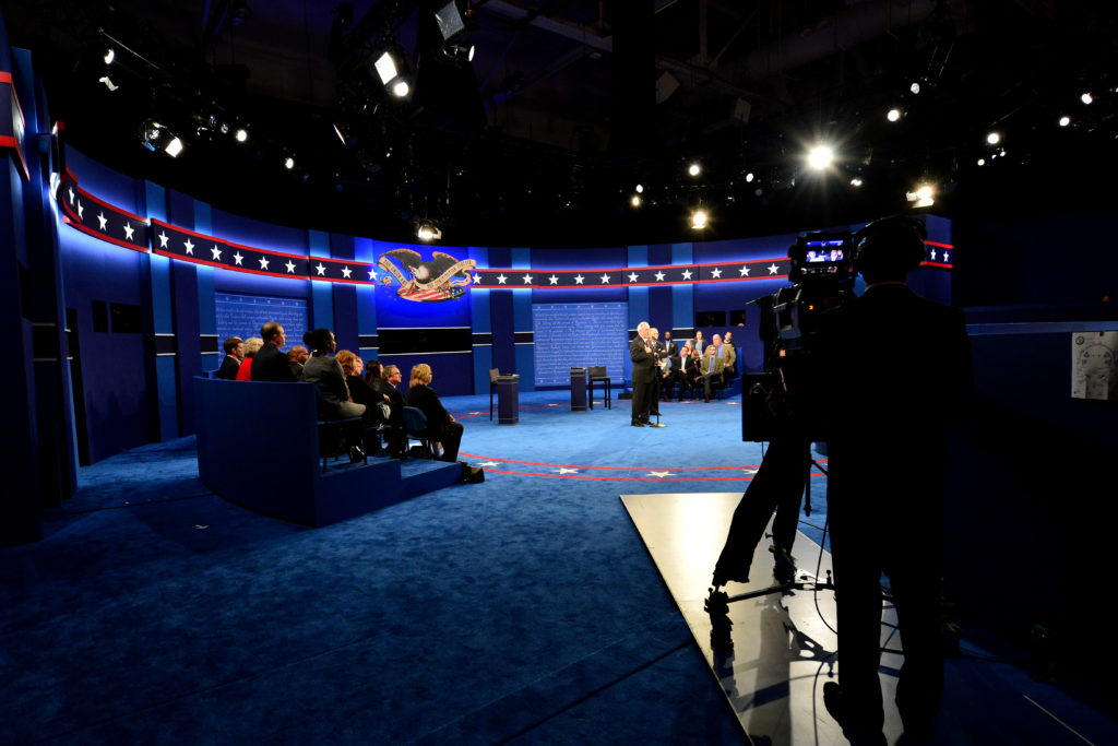 Moments before the candidates appear, members of the Commission on Presidential Debates welcome participants to the town hall at Washington University in St. Louis. (Photo: Joe Angeles/Washington University)