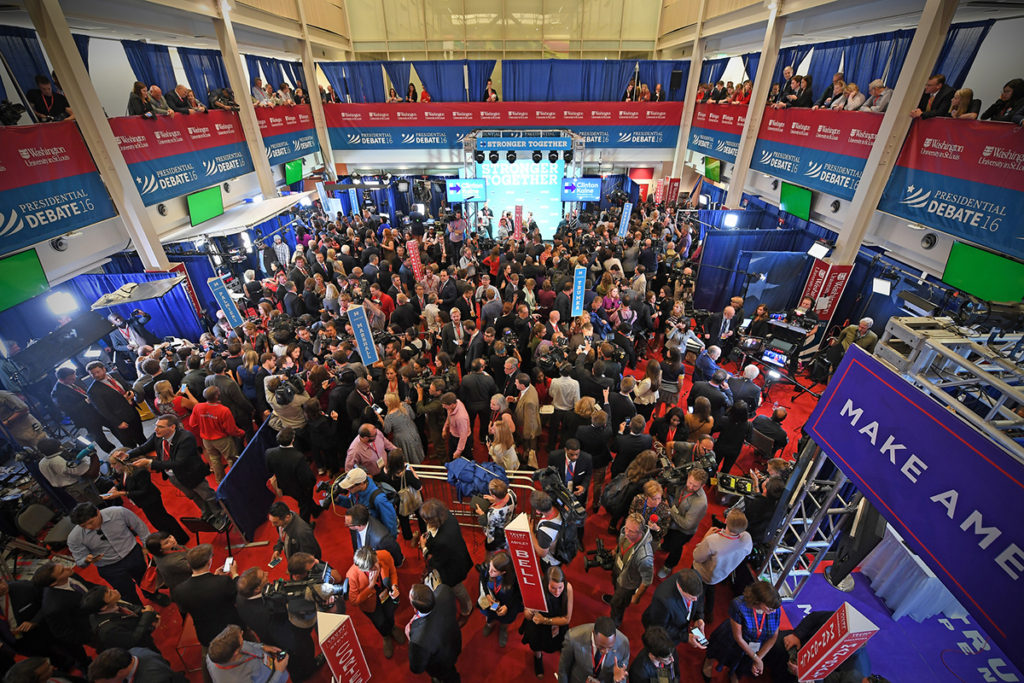 journalists crowd Spin Alley